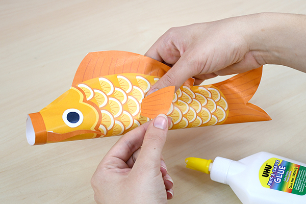 To decorate a child's room, make beautiful colorful Koinobori fish to hang as a garland to celebrate spring.